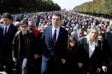 Ekrem Imamoglu, main opposition Republican People's Party (CHP) candidate for mayor of Istanbul, visits Anitkabir, the mausoleum of modern Turkey's founder Mustafa Kemal Ataturk, as he is flanked by his family members and supporters in Ankara, Turkey, April 2, 2019. REUTERS/Umit Bektas/File Photo