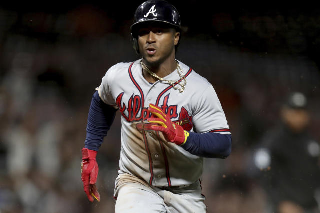 Atlanta Braves shortstop Ozzie Albies (1) scores on a sac fly by Atlanta Braves shortstop Dansby Swanson (7) in the seventh inning of a baseball game in San Francisco, Monday, Sept. 10, 2018. (AP Photo/Scot Tucker)