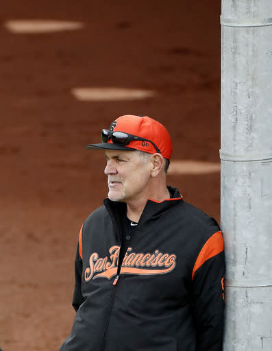San Francisco Giants manager Bruce Bochy watches his team during a baseball spring training practice, Wednesday, Feb. 13, 2019, in Scottsdale, Ariz. (AP Photo/Matt York)