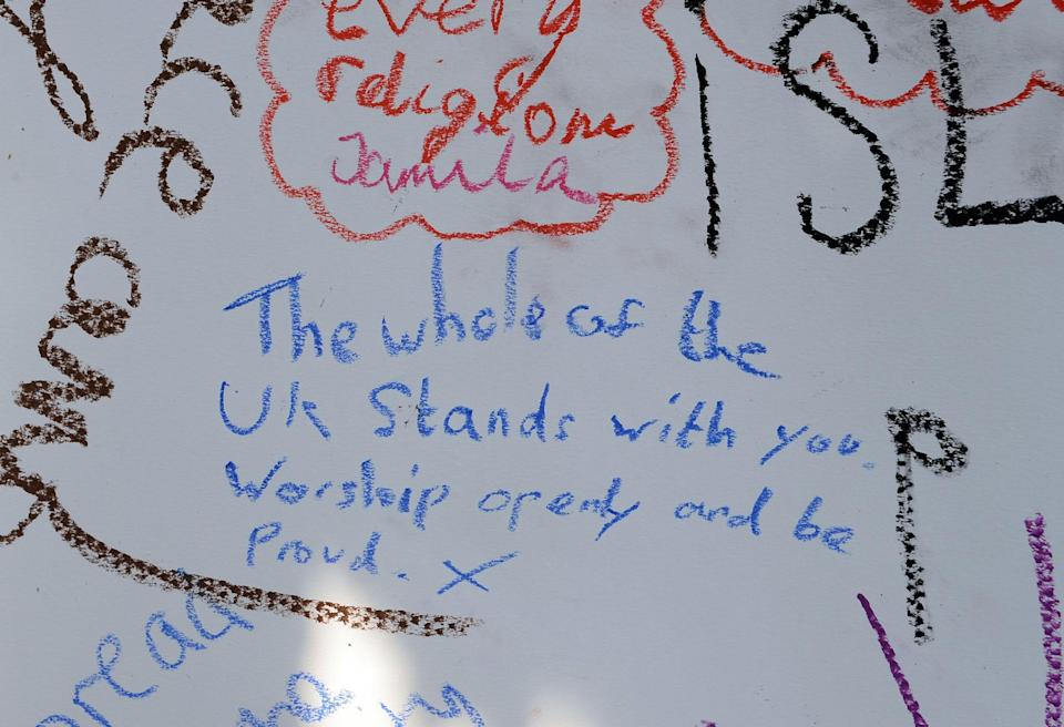 Tributes written by members of the public at the Finsbury Park mosque (PA Images)