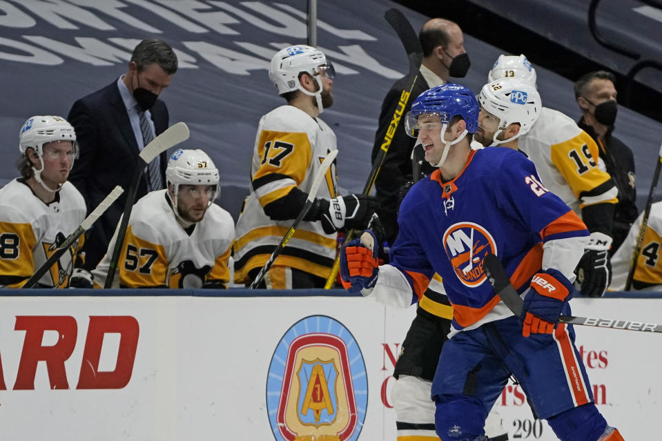 New York Islanders Oliver Wahlstrom (26) skates past the Pittsburgh Penguins bench after scoring on a power play at the end of the first period of an NHL hockey game, Sunday, Feb. 28, 2021, in Uniondale, N.Y. (AP Photo/Kathy Willens)