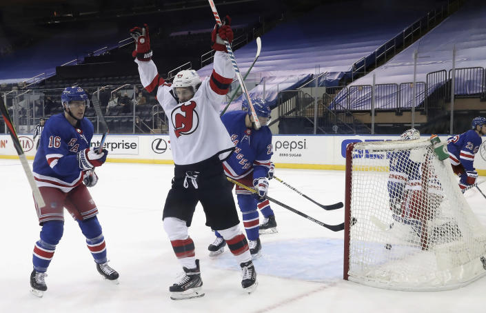 New Jersey Devils' Miles Wood celebrates a second-period goal against the New York Rangers in an NHL hockey game Tuesday, Jan. 19, 2021, in New York. (Bruce Bennett/Pool Photo via AP)