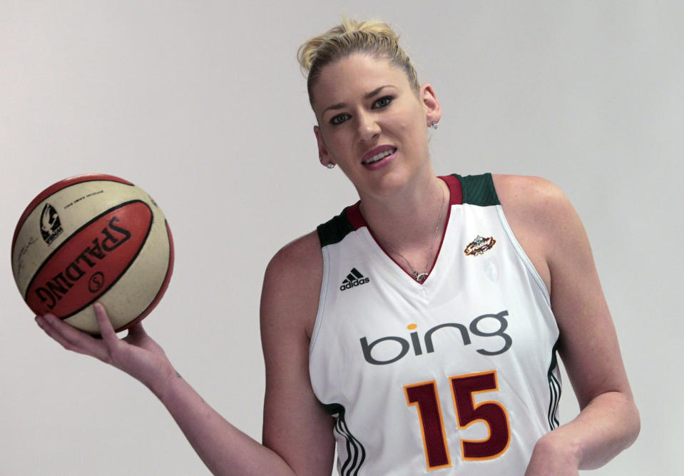 FILE - In this May 27, 2011, file photo, Seattle Storm's Lauren Jackson, from Australia, waits to be photographed during the team's media day event in Seattle. The Australian Women's National Basketball League says, Friday, Oct. 9, 2020, because of restrictions amid the COVID-19 pandemic, the eight teams will relocate to Queensland state and operate in a bio-security bubble for the duration of the regular season. (AP Photo/Elaine Thompson, File)