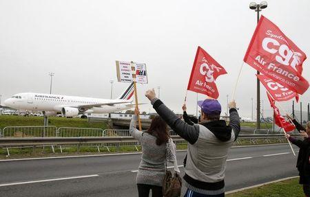 Striking employees of Air France demonstrate in front of the Air France headquarters building at the Charles de Gaulle International Airport in Roissy, near Paris, France, October 5, 2015. REUTERS/Jacky Naegelen