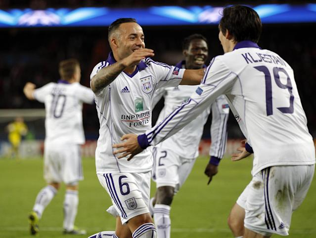 Anderlecht's Demy De Zeeuw, left, celebrates his opening goal with Sacha Kljestan during their Champions League group C soccer match against Paris Saint Germain in Paris, France, Tuesday, Oct. 5, 2013. (AP Photo/Michel Euler)