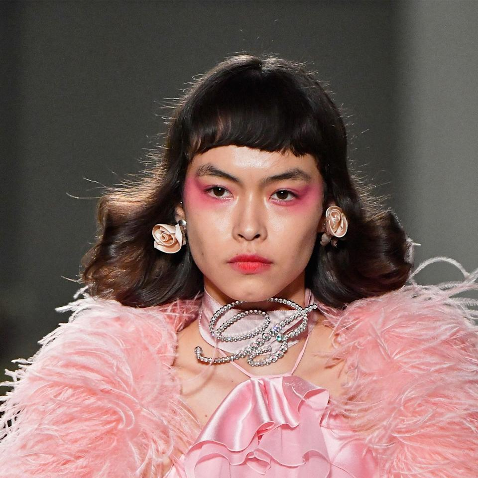 """On days when no amount of concealer will disguise your under-eye circles, look to the look that hit the runway at Blumarine for an vibrant alternative. Makeup artist Inge Grognard swept fuchsia shadow along lower lashes and upward toward the temples for a gorgeous draping-meets-underliner look. A more orange-toned pink topped lips to tie together the dreamy look. We'll be recreating it with the <a href=""""https://shop-links.co/1719026072795165689"""" rel=""""nofollow noopener"""" target=""""_blank"""" data-ylk=""""slk:Juvia's Place The Sweet Pinks Eyeshadow Palette"""" class=""""link rapid-noclick-resp"""">Juvia's Place The Sweet Pinks Eyeshadow Palette</a> and <a href=""""https://shop-links.co/1719026007074355153"""" rel=""""nofollow noopener"""" target=""""_blank"""" data-ylk=""""slk:Make Up For Ever's Rouge Artist Lipstick"""" class=""""link rapid-noclick-resp"""">Make Up For Ever's Rouge Artist Lipstick</a> in 306 Edgy Marmalade."""