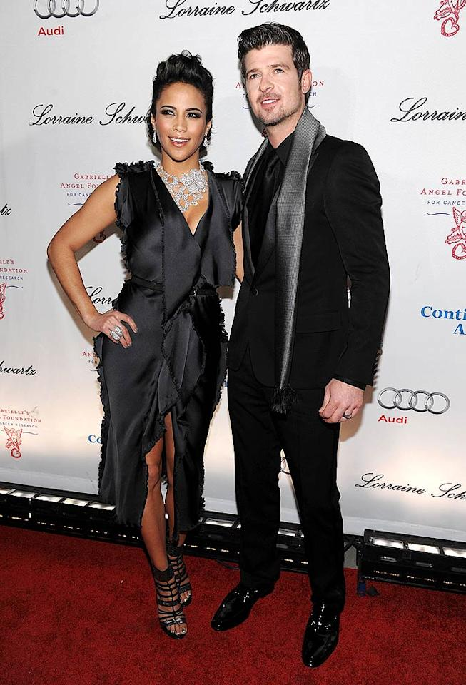 """Singer Robin Thicke attended with his wife, actress Paula Patton. While she's been busy lately shooting the film """"Just Wright"""" with Queen Latifah, Thicke's been blasting out speakers on Leighton Meester's new single, """"Somebody to Love."""" Dimitrios Kambouris/"""