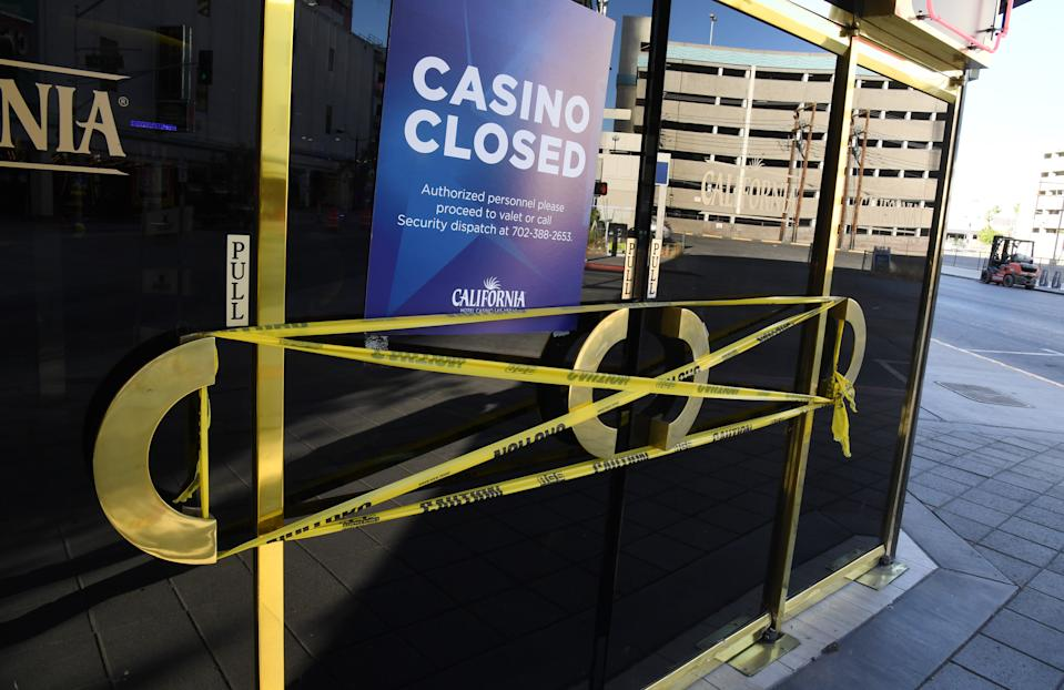 LAS VEGAS, NEVADA - MAY 27:  An entrance at the closed California Hotel & Casino in downtown is wrapped in caution tape due to the statewide shutdown because of the coronavirus pandemic on May 27, 2020 in Las Vegas, Nevada. Nevada Gov. Steve Sisolak ordered all hotel-casinos and other nonessential businesses statewide closed on March 17 to help fight the spread of COVID-19. Sisolak announced on Wednesday that as part of a phased reopening of the economy, resorts throughout the state will be able to reopen on June 4, pending receipt of final regulatory approvals. Boyd Gaming Corp. announced today that it plans to resume operations at nine of its Nevada properties on June 4, including the California.  (Photo by Ethan Miller/Getty Images)