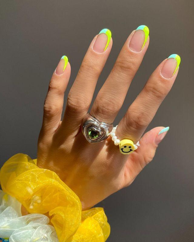 "<p>Forget classic French, this summer's manicure is all about Miami-inspired neon tips with asymmetric swerves and curves.</p><p><a href=""https://www.instagram.com/p/CNxj2XunSiO/?utm_source=ig_embed&utm_campaign=loading"" rel=""nofollow noopener"" target=""_blank"" data-ylk=""slk:See the original post on Instagram"" class=""link rapid-noclick-resp"">See the original post on Instagram</a></p>"