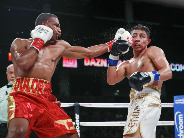 Thomas Dulorme, left, hits Jessie Vargas during the WBC welterweight boxing match Saturday, Oct. 6, 2018, in Chicago. (AP Photo/Kamil Krzaczynski)