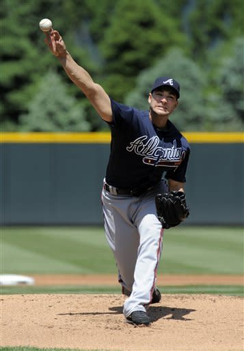 Atlanta Braves starting pitcher Brandon Beachy throws to the Colorado Rockies during the first inning of a baseball game Sunday, May 6, 2012, in Denver. (AP Photo/Jack Dempsey)