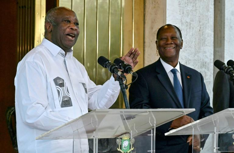 Ivory Coast President Alassane Ouattara (R) and his predecessor and former rival Laurent Gbagbo (L) met for the first time since the crisis