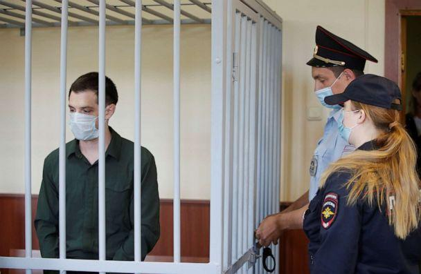 PHOTO: In this July 30, 2020, file photo, former U.S. Marine Trevor Reed, who was detained in 2019 and accused of assaulting police officers, stands inside a defendants' cage during a court hearing in Moscow. (Maxim Shemetov/Reuters, FILE)