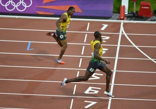 Jamaica's Usain Bolt looks across at teammate Yohan Blake as he beats him to the finish line to take gold in the men's 200m Olympic final on August 9. On the eve of the Olympics, a veil of intrigue had been draped across Usain Bolt's preparations for the defence of his 100m and 200m titles. It took precisely 9.63 seconds for the questions to be erased, as Bolt coasted to victory in the 100m