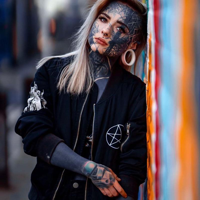 Nadine Anderson, a 23-year-old care assistant from Dundee, Scotland, can be seen with tattoos on the majority of her face. Source: Australscope