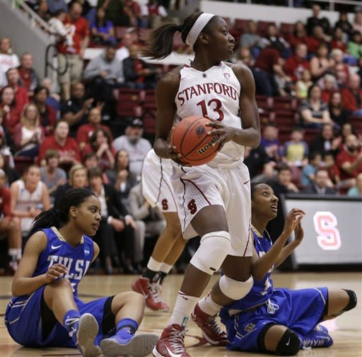 Stanford's Chiney Ogwumike (13) looks to pass downcourt after securing a rebound from Tulsa's Ashley Clark, left, and Taleya Mayberry during the first half of a first-round game in the women's NCAA college basketball tournament on Sunday, March 24, 2013, in Stanford, Calif. (AP Photo/Ben Margot)