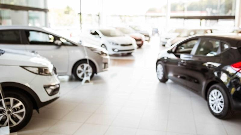 New cars in car dealership showroom
