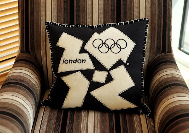 A London 2012 branded cushion is placed on an armchair at the launch of the London Olympic Games official merchandise on July 30, 2010 in London, England. The merchandise is being launched with two years to go before the Games begin and features a range of goods including: clothing, towels, bedding, ceramics, stamps, coins, badges, mascot toys and soft furnishings. (Photo by Oli Scarff/Getty Images)