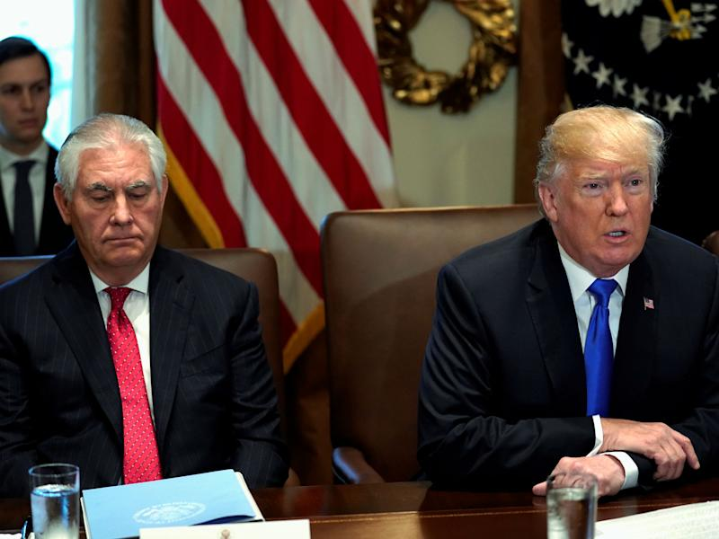 Mr Tillerson pictured seated beside Mr Trump at the White house: Reuters