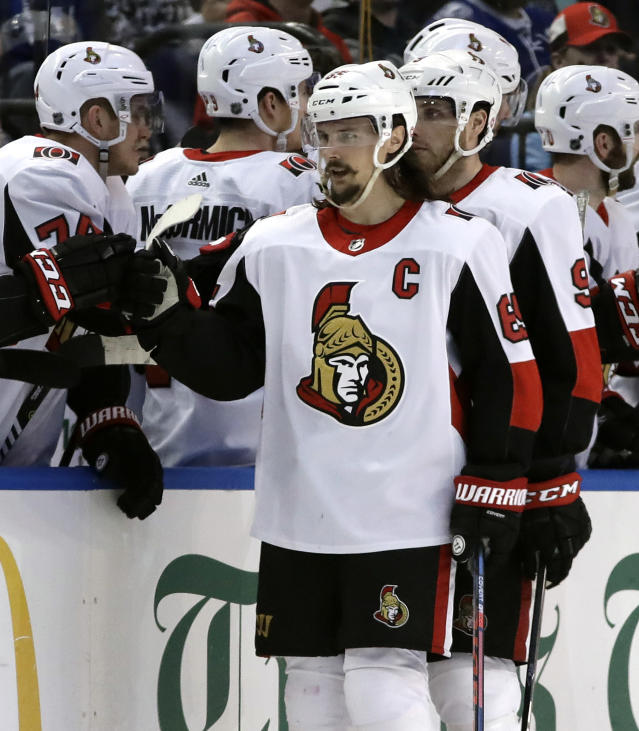Ottawa Senators defenseman Erik Karlsson, (65) of Sweden, celebrates with the bench after his goal against the Tampa Bay Lightning during the second period of an NHL hockey game Tuesday, March 13, 2018, in Tampa, Fla. (AP Photo/Chris O'Meara)