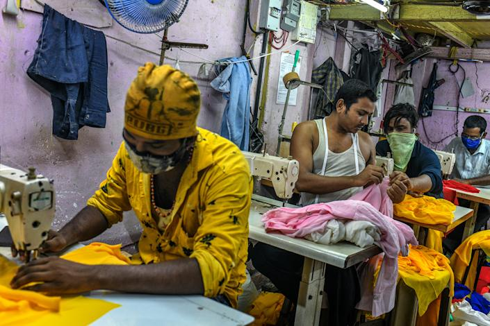 """""""My family was worried about the disease and didn't want me to return to the city, but I had to come back to work,"""" said Ishrar Ali, who stitches women's tops in a garment workshop in Dharavi.<span class=""""copyright"""">Atul Loke for TIME</span>"""