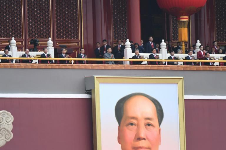 Chinese President Xi Jinping (C) attends the celebration of the 100th anniversary of the founding of the Communist Party of China at Tiananmen Square in Beijing