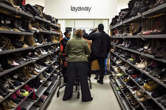 Black Friday shoppers line up at a layaway counter at a TJ Maxx store in Alexandria, Virginia. (REUTERS/James Lawler Duggan)