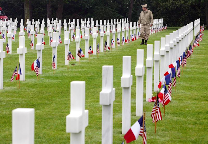 An unidentified visitor wearing a U.S. military nurse uniform walks past graves at the American cemetery, in Colleville-sur-Mer, western France, on June 6, 2007 .