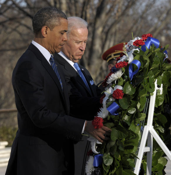 President Barack Obama and Vice President Joe Biden place a wreath at the Tomb of the Unknowns at Arlington National Cemetery in Arlington, Va., Sunday, Jan. 20, 2013. (AP Photo/Susan Walsh)