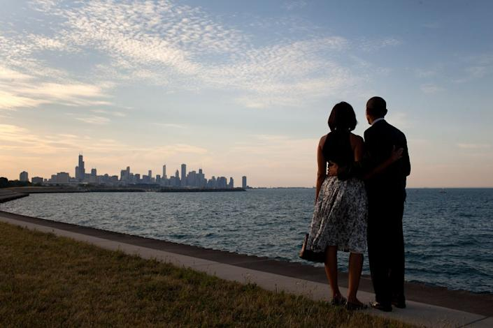 """The President and First Lady look out at the city skyline and Lake Michigan after arriving at the Burnham Park landing zone in Chicago, Ill., June 15, 2012. (Pete Souza / The White House) <br> <br> <a href=""""http://lightbox.time.com/2012/10/08/pete-souza-portrait-of-a-presidency/#1"""" rel=""""nofollow noopener"""" target=""""_blank"""" data-ylk=""""slk:Click here to see the full collection at TIME.com"""" class=""""link rapid-noclick-resp"""">Click here to see the full collection at TIME.com</a>"""