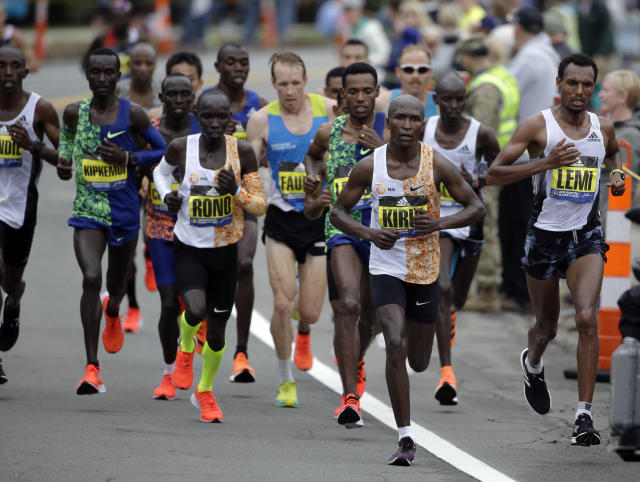 Geoffrey Kirui, of Kenya, leads the pack during the 123rd Boston Marathon on Monday, April 15, 2019, in Newton, Mass. (AP Photo/Steven Senne)
