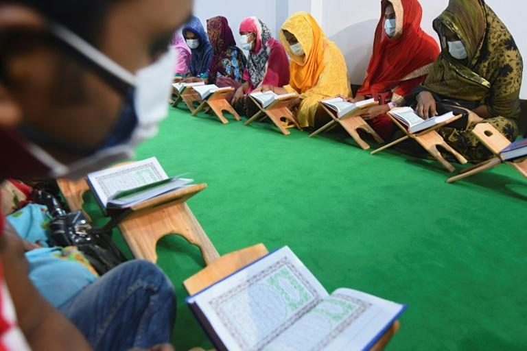 Transgender students busy with their studies at the Dawatul Islam Tritio Linger Madrasa in Bangladesh