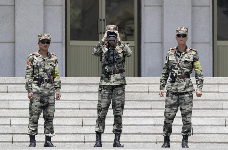 In this June 12, 2019, photo, North Korean soldiers look at the South side, seen during a press tour at the Panmunjom in the Demilitarized Zone (DMZ), South Korea. U.S. President Donald Trump on Saturday, June 29, 2019, invited North Korean leader Kim Jong Un to shake hands during a visit by Trump to the DMZ with South Korea. (AP Photo/Lee Jin-man)