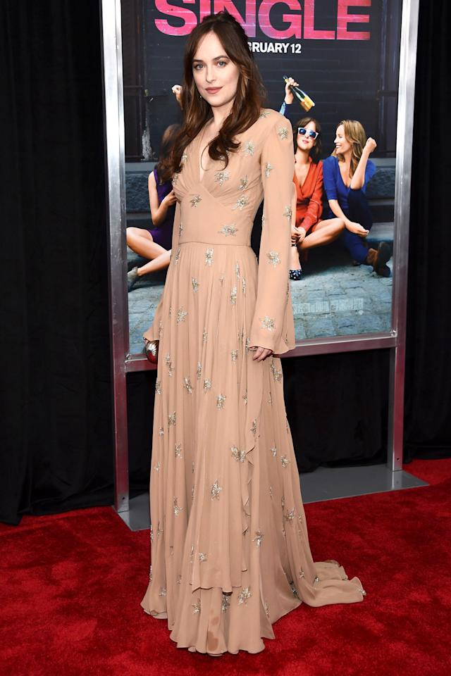 "<p>Dakota Johnson's star-studded empire-waist Saint Laurent gown gets a Stevie Nicks affect with a gathered neckline and bell sleeves at the New York premiere of <em>How To Be Single.</em></p><p><em><br></em></p><p><strong>Get the look</strong>: Unbridaled by Dan Jones ""Stevie"" gown, $4,815, <a rel=""nofollow"" href=""http://www.dan-jones.com/index.php/collections/unbridaledbydanjones/stevie.html"">dan-jones.com</a>.</p>"