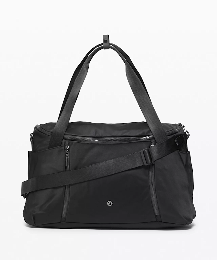 """<h2>Lululemon Define Duffle</h2><br>This classic duffle has several exterior and interior pockets, including one for a laptop. It's also made out of water-repellent fabric which makes this bag easy to wipe clean and great for the wet and rainy fall months.<br><br><em>Shop <strong><a href=""""https://shop.lululemon.com"""" rel=""""nofollow noopener"""" target=""""_blank"""" data-ylk=""""slk:Lululemon"""" class=""""link rapid-noclick-resp"""">Lululemon</a></strong></em><br><br><strong>Lululemon</strong> Define Duffle, $, available at <a href=""""https://go.skimresources.com/?id=30283X879131&url=https%3A%2F%2Fshop.lululemon.com%2Fp%2Fbags%2FDefine-Duffel%2F_%2Fprod9960669"""" rel=""""nofollow noopener"""" target=""""_blank"""" data-ylk=""""slk:Lululemon"""" class=""""link rapid-noclick-resp"""">Lululemon</a>"""
