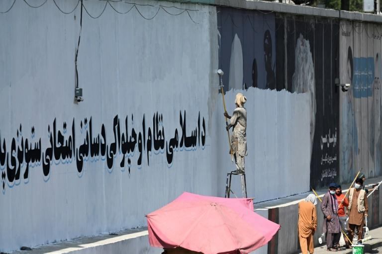 Within weeks of capturing Kabul, the Taliban have started replacing many of the city's murals with propaganda slogans (AFP/Aamir QURESHI)