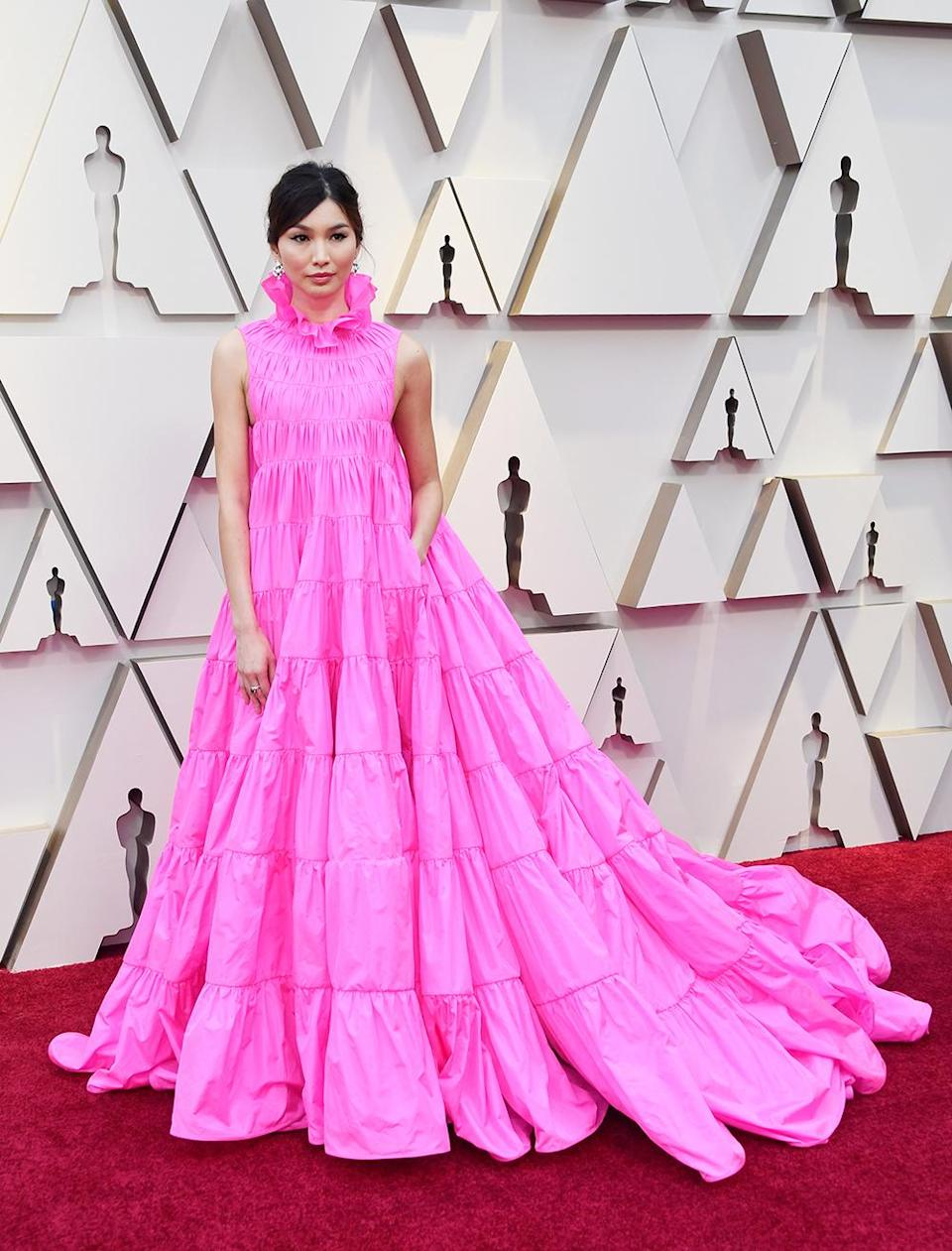 """<p>The """"Crazy Rich Asians"""" star looked fashion forward in a bright pink ruffled gown (with pockets) by Valentino. A catwalk-fresh look, we should add, that literally made Celine Dion cry with joy during Haute Couture Fashion Week last month.<em> [Photo: Getty]</em> </p>"""