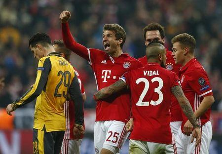 Bayern Munich's Thomas Muller celebrates scoring their fifth goal with teammates