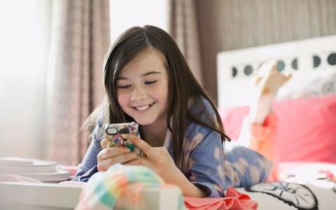 Child using smart phone - Credit: Getty Images Contributor