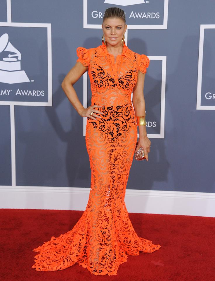Fergie takes it to a whole new level in an all lace orange dress.