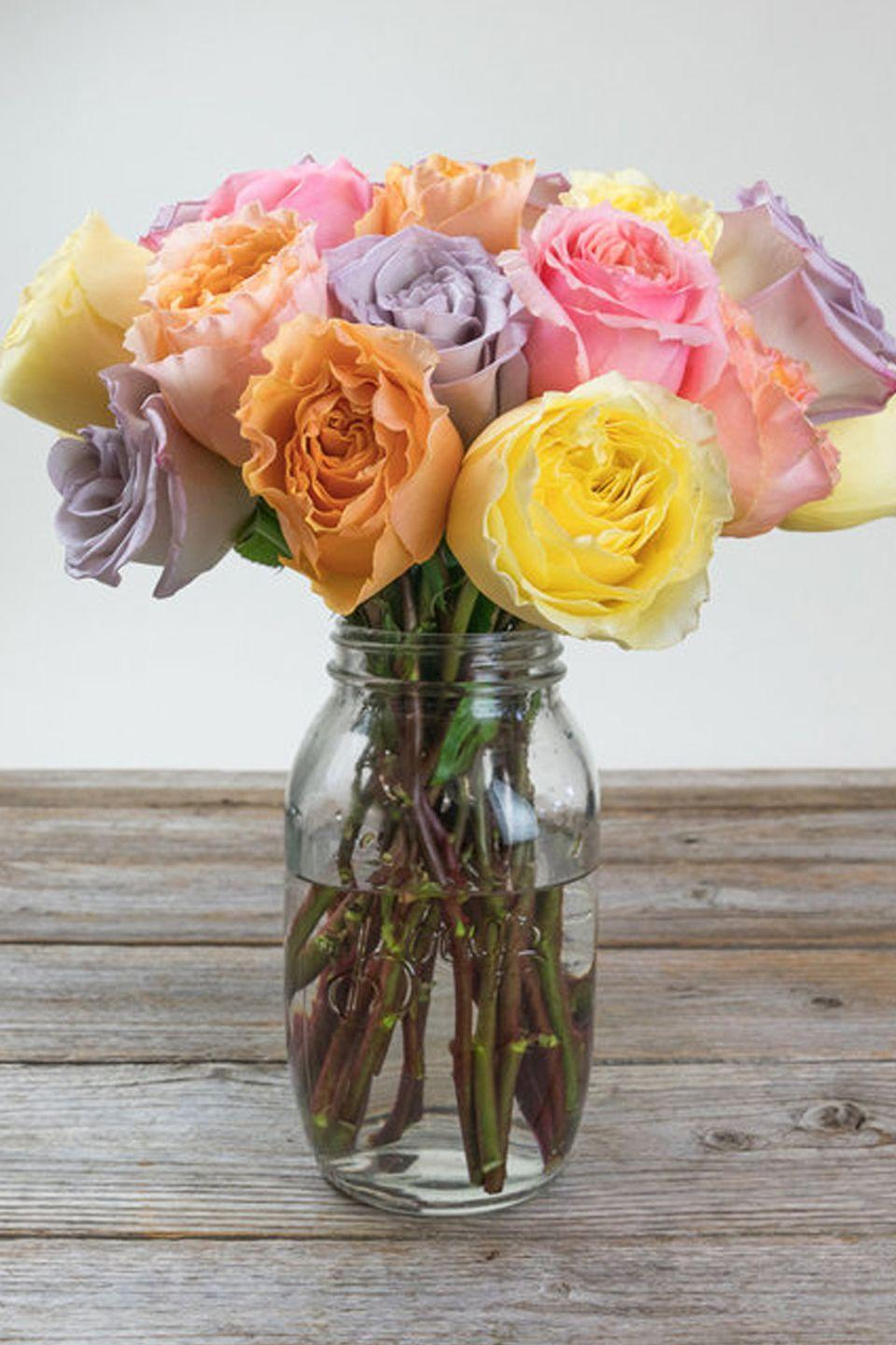 """<p>If you prefer to buy your display, this arrangement of yellow, peach, pink, and lavender roses will blend perfectly with the pastel hues commonly found on this holiday.<strong><em><br></em></strong></p><p><strong><em>LSA International Glass Vase Trio, $45</em></strong> <a class=""""link rapid-noclick-resp"""" href=""""https://go.redirectingat.com?id=74968X1596630&url=https%3A%2F%2Fwww.westelm.com%2Fproducts%2Ftotem-colored-glass-vases-d5977%2F&sref=https%3A%2F%2Fwww.housebeautiful.com%2Fentertaining%2Fflower-arrangements%2Fg19409803%2Feaster-flower-arrangements%2F"""" rel=""""nofollow noopener"""" target=""""_blank"""" data-ylk=""""slk:BUY NOW"""">BUY NOW</a></p>"""