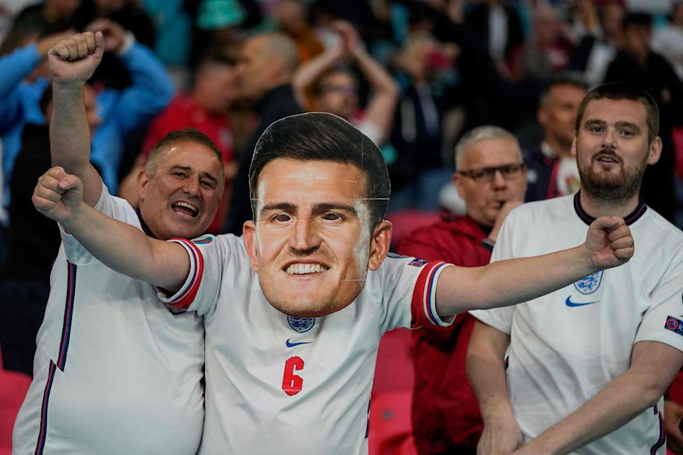 An England supporter wearing a Harry Maguire mask (AFP/Getty)