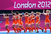 Netherlands women's national hockey team celebrate after winning their women's Group A hockey match against Belgium at the London 2012 Olympic Games at the Riverbank Arena on the Olympic Park in London July 29, 2012. REUTERS/Suzanne Plunkett