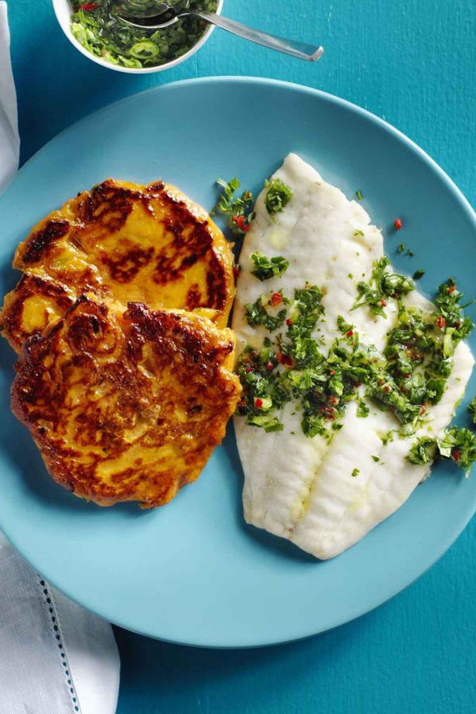 """<p>This tilapia tastes out-of-this-world good thanks to the chimichurri sauce on top and the sweet potato side.</p><p><a href=""""https://www.womansday.com/food-recipes/food-drinks/recipes/a57690/tilapia-sweet-potato-cakes-chimichurri-recipe/"""" rel=""""nofollow noopener"""" target=""""_blank"""" data-ylk=""""slk:Get the recipe for Tilapia with Sweet Potato Cakes and Chimichurri."""" class=""""link rapid-noclick-resp""""><em>Get the recipe for Tilapia with Sweet Potato Cakes and Chimichurri.</em></a></p>"""