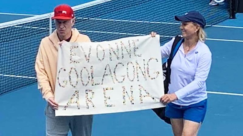 Tennis greats John McEnroe and Martina Navratilova unfurled a banner calling for Margaret Court Arena to be renamed Evonne Goolagong Arena after a legends match at the Australian Open. Picture: Twitter