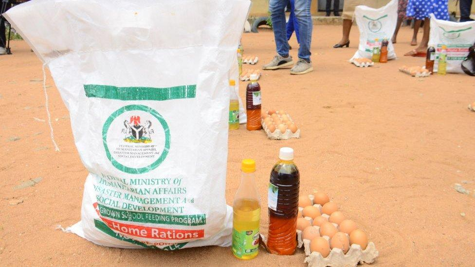 A crate of egg, a bottle of palm oil and a bag of rice