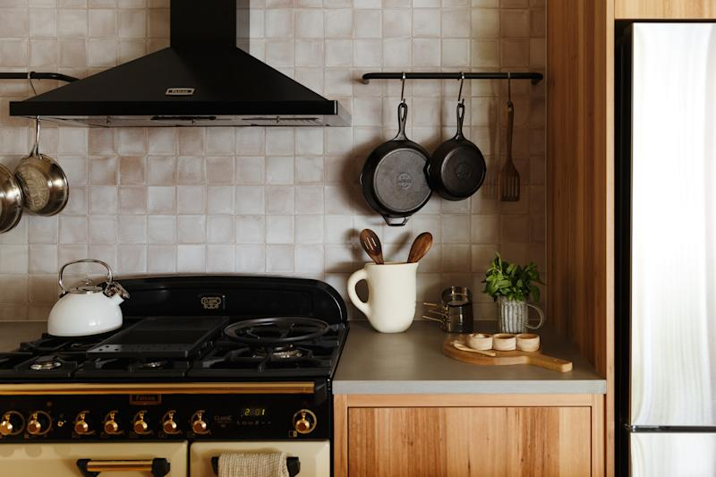 AFTER: As a nod to the home's Victorian architecture, the team chose a Falcon Classic Deluxe dual fuel oven for its throwback look—and a matching range. That showpiece is complemented by a Fisher and Paykel refrigerator and an AEG dishwasher.