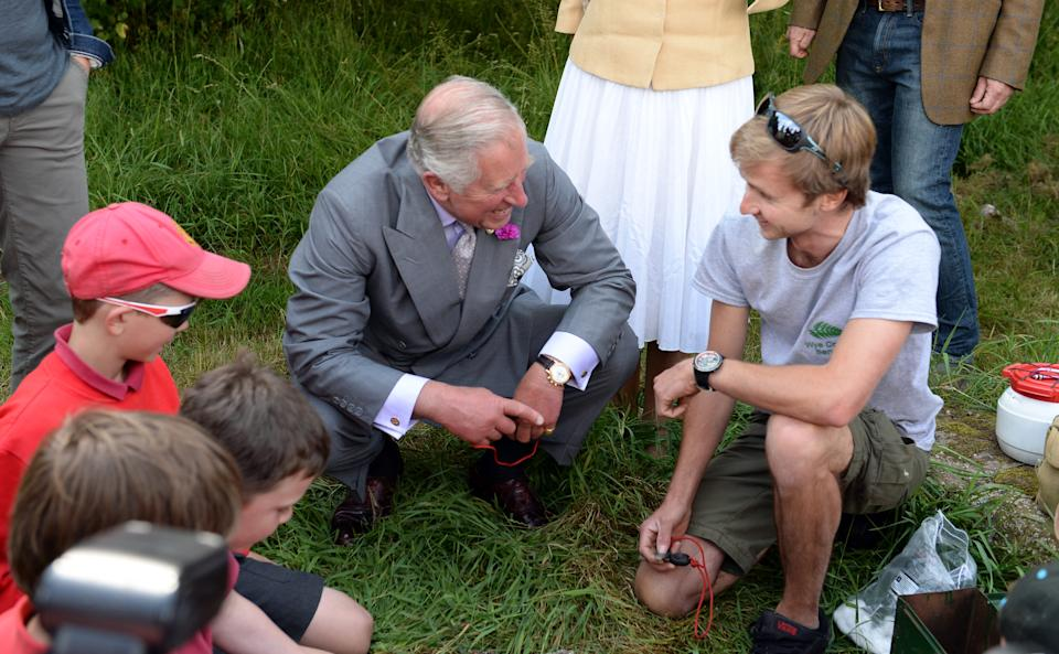MONMOUTH, WALES - JULY 09:   Prince Charles, Prince of Wales takes part in a bush-skills class during a visit to  'Humble by Nature', a working organic farm run by broadcaster Kate Humble, on July 09, 2015 in Monmouth, Wales. (Photo by Anwar Hussein/WireImage)