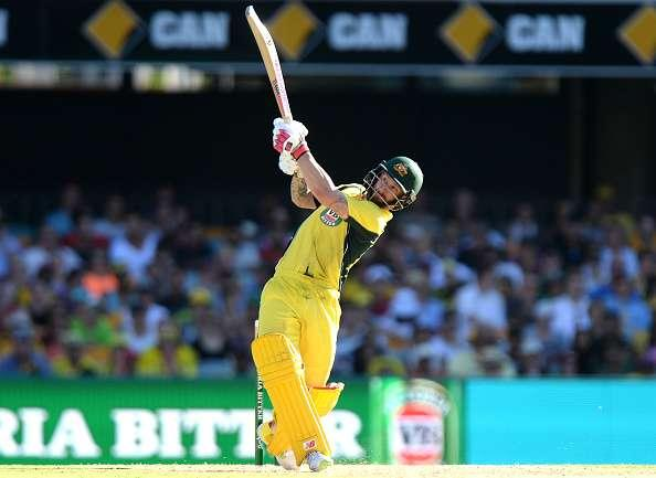 BRISBANE, AUSTRALIA - JANUARY 13: Matthew Wade of Australia hits the ball over the boundary for a six during game one of the One Day International series between Australia and Pakistan at The Gabba on January 13, 2017 in Brisbane, Australia. (Photo by Bradley Kanaris/Getty Images)