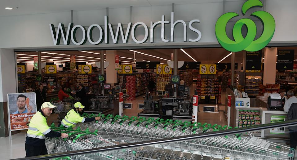 A file picture of workers collecting trolleys outside a Woolworths store.